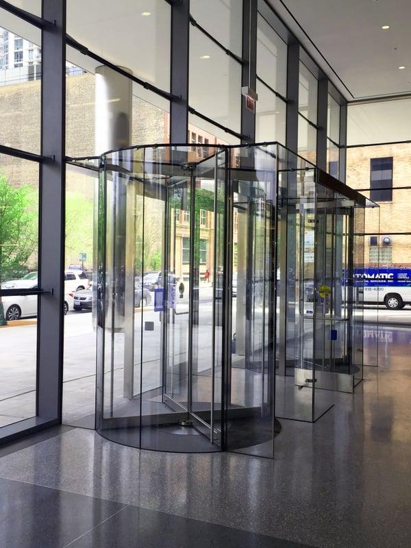 Revolving doors integrated with vestibules