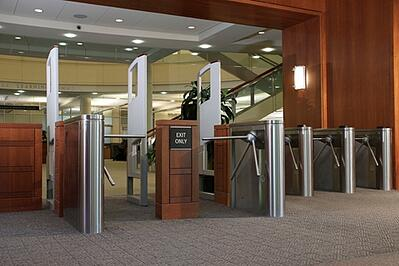 Tripod turnstiles can be set to freely rotate in an emergency
