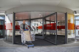 large capacity revolving door accommodates shopping cart