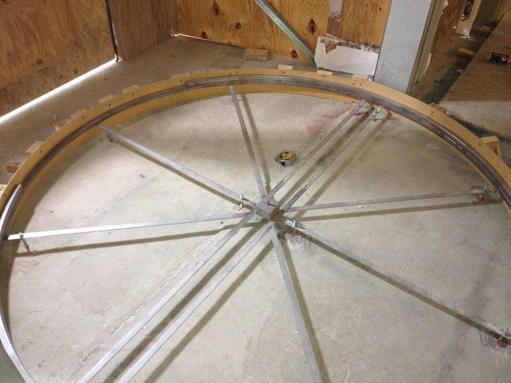 Floor frame or matwell ring for a revolving door installation