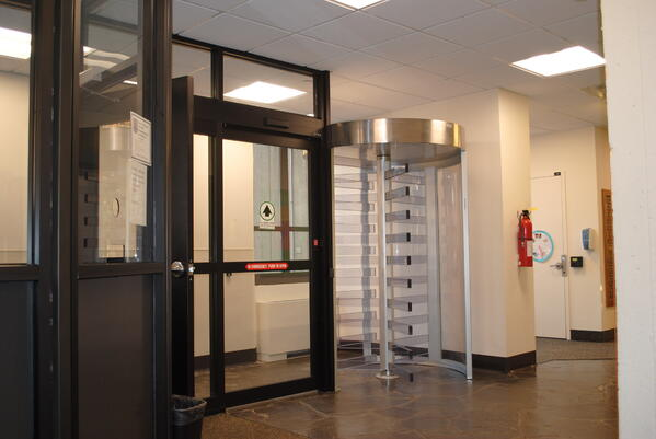 Full height turnstile with Lexan panels for indoor application